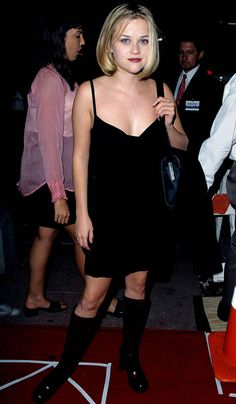 A young Reese Witherspoon was no stranger to the slinky LBD — complete with knee-high boots — at The House of Yes premiere in Reese Witherspoon, Fashion History, 90s Fashion, Fashion Photo, Vintage Fashion, 90s Outfit, Fashion Articles, Iconic Women, Preppy Style