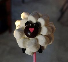 little lamb cake pops for Easter! What I came for. I could maybe manage these. Cute!