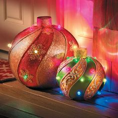 Giant outdoor lighted ornaments httpthegreenhead201112 get these oversized lighted led outdoor christmas ornaments and make a big and bold statement both ornaments produce a random light show with leds aloadofball Image collections