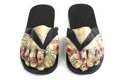 I'm going to get these and wear them to work (i'm a nail technician) then tell them this is what happens to your feet when they go elsewhere!  zombie feet sandals - who wouldn't want these?!