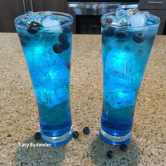 Fast and furious  1oz rum 1oz coconut rum 1oz apple pucker 1oz blue curaco 1 oz lemon line soda Fill with soda Garnish with blueberries  Glow in the dark ice cubes get at amazon.