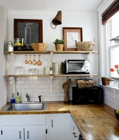 Planked wall + open shelving + butcher block <3 Awesome #DIY kitchen remodel!