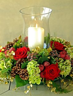 Put Christmas flowers in instead of roses. Christmas Holiday Flower Arrangement with Hurricane Candle Centerpiece Christmas Flower Decorations, Christmas Flower Arrangements, Christmas Flowers, Noel Christmas, Christmas Candles, Christmas Centerpieces, Modern Christmas, Christmas Wreaths, Christmas Crafts