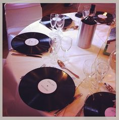 LPs - different sizes, coloured centres (or not) - we were going to do this for a 50s themed celebration - using them as plate liners and centrepiece bases, as well as part of the ceiling decor... budget fell thru, but waiting for the right client to love the idea as much as we do!!