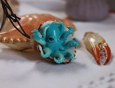 Blue octopus inside a seashell/ pendant necklace jewelry/handmade polymer clay
