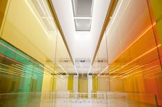 21 Cake Headquarters, via DesignBoom. The white surfaces in the interior act as backdrops for the laminated panes of primary colors, red, blue and yellow. The colored planes appear to overlap, creating fresh color combinations from new angles.