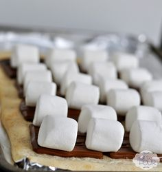 Smores Pizza Recipe (use sugar cookie dough & maybe melt chocolate & use marshmallow cream & allow to cool before cutting)