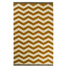 yes, another zigzag rug, but this color could work well with the brown sofa