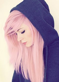 Long straight pastel pink hair with long side swept bangs hairstyle