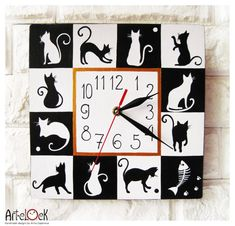 The Black and White Cats Hand Painted Wall Clock by ArtClock, $40.00