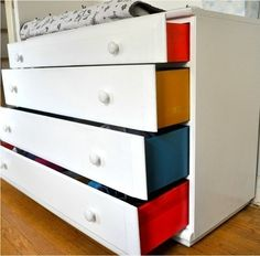 If you'd rather keep your drawers white, paint on the inside to create this surprise. | 27 DIY Ways To Give Your House A Quick Pick-Me-Up