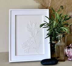 Pinhole art made with a piece of paper and a pushpin - doing this for my bathroom!