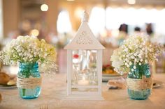 25 Inspiring Baby's Breath Arrangements for Weddings: Small jars with baby's breath
