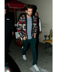 Scott Disick knows how to wear trends, sporting dark green jeans in a casual way.