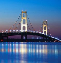 Dining room wall art: Mackinac Bridge Mackinaw City, St. Ignace, Michigan.   Third largest suspension bridge in the world, spanning 5 miles between the upper and lower peninsulas of Michigan. Mackinaw City is on the south end of the bridge while St. Ignace is on the north end.