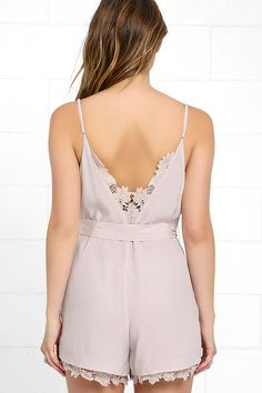 The world is your oyster in the Adventure of a Lifetime Taupe Lace Romper! Gauzy woven fabric is decoratively embellished with lace panels along the V-back and hems. V-neckline with a loop button placket tops a belted waist with relaxed shorts.