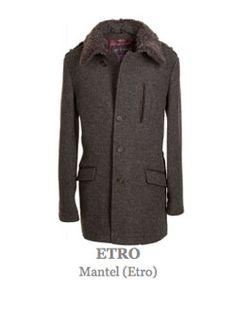 Mantel des italienischen Luxuslables Etro. Moderner Mantel, leicht tailliert und knielang geschnitten.  Kragen aufwendig mit Schaffell verbrämt. Hinten einseitig geschlitzt.  Seitlich zwei Taschen mit Überhang,  schließt mit einer durchgehenden  Knopfleiste mit Knöpfen auf denen das Markenlogo eingeprägt ist.  Farbe: Grau Anthrazit