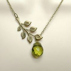 Brass leaf and olive green glass pendant.