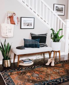 This set up is nice. Back door/mudroom? Plants are a nice touch. I'd make that geometric object below the bench a light, though. Nice nightlight on a timer would be great by the back door. Plants are a nice touch, too.
