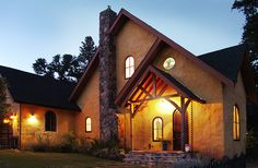 Home exterior of StrawBale House by American Clay Enterprises, via Flickr. This is a great example that not all StrawBale homes have to look like they are ready for the desert. Made with American Clay - a great fire-resistant, energy efficient choice.