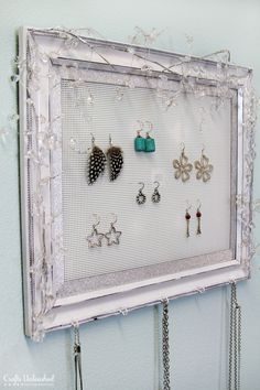 DIY jewelry organizer using plastic canvas (vinyl weave) instead of chicken wire. Would be cute gift for a tween/teen.