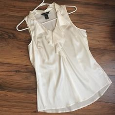 WHBM Silk top with v-neck Topped with a ruffled flounce, sleeveless silk top with a light and lush feel. White House Black Market Tops