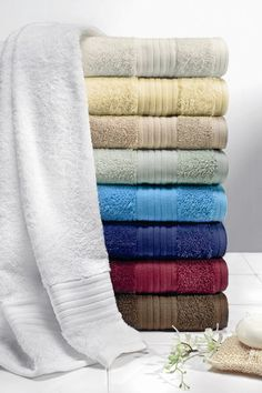 Enjoy the experience of this ultra soft absorbent cotton towel. Made from 100% long staple East African cotton, this towel adds an elegant touch to any bathroom. This product is OEKO-TEX Certified - for the protection of the manufacturer's employees and the product's consumers, no harmful substances are used in the manufacturing process.