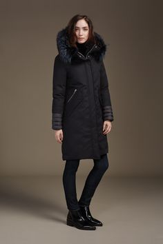 CAROLANN is a straight fit, above the knee length hooded coat with removable fur trim and high-low hem. The essence of casual luxury, this down-filled coat is replete with stylish, wearable details: sherpa-lined hood and centre, flap closure, zippered angle pockets and flap pockets at front. Discover at http://www.soiakyo.com/ca/en/carolann-hooded-coat-with-removable-fur-in-black-for-women