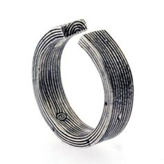 Designed by Brooklyn based Aaron Ruff. (via swissmiss)  Fingerprint ring. Brilliant!