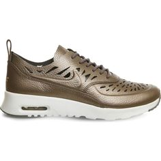 Nike Air Max Thea cutout metallic leather trainers (£88) ❤ liked on Polyvore featuring shoes, sneakers, metallic pewter, lightweight sneakers, low top, leather shoes, lightweight shoes and nike shoes