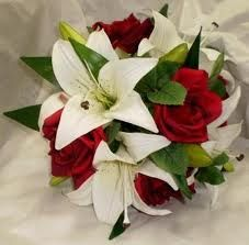 bouquet with red roses and white tiger lillies  this is definately an idea for whenever we renew our vows :)
