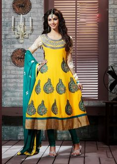 The fascinating beautiful subtly garment with lovely patterns.  The dazzling yellow georgette anarkali churidar suit have amazing embroidery patch work is done with resham, zari, stone and lace work.  Beautiful embroidery work on kameez is stunning.  The entire ensemble makes an excellent wear.  Contrasting dark teal green santoon churidar and dark teal green chiffon dupatta is available with this suit