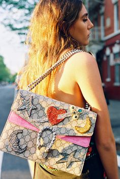 Leila Rahimi, 24 in a vintage top and a Gucci Dionysus bag with rhinestones and bead appliqués.