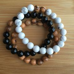 Olive Wood 3 Pack with Howlite and Black Onyx *Howlite is a calming stone, perfect for facilitating personal and spiritual awareness and attunement. *Black Onyx is a powerful protective stone, capable of absorbing and transforming negative energy.