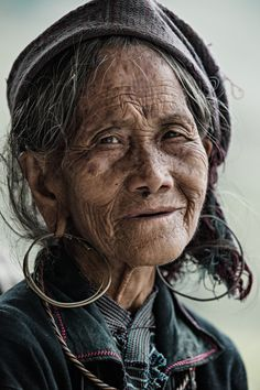 a weathered face, that has seen a lot of hard work, I bet, and life out in the open air