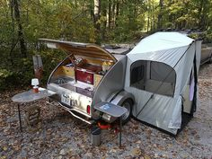 Tiny Yellow Teardrop - tent attached to camper.  This looks like an entryway where you can clean your feet, sit in a chair, a little extra space.