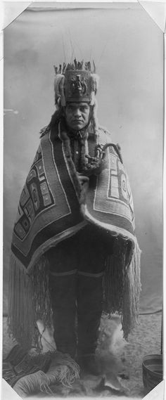Native American shaman of the North pacific coast in ceremonial dress. NARA