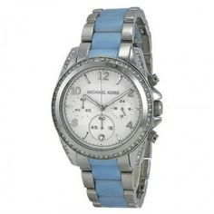 Michael Kors Silver-Tone Blair Watch Michael Kors Silver-Tone Blair Watch. A two-tone bracelet featuring chambray blue and stainless steel adds a feminine touch to the Blair watch. Pavé crystals and a sleek white dial. Date display at the 6:00 position. Chronograph three sub-dials displaying: 60 second, 60 minute and 24 hour. Case diameter: 39mm. Band width: 20mm. Band length: 7.2 inches. Deployment clasp with push button release. Water resistant at 100 meters. Functions: chronograph, date…