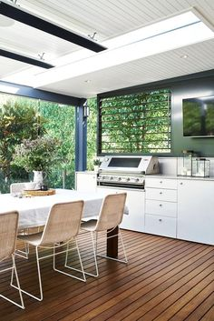 David Campbell Building - outdoor kitchen on the deck, white cabinets
