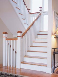#Classic - An understated symphony of planes and angles.  The long, square #balusters can be installed two ways: on the outside of the handrail for a fresh, #modern effect or beneath the handrail for a look inspired by the principles of Federal design.