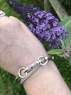 The stunning Cherry Roller with purple CZ crystals from Hiho Silver, shown next to the Hiho Silver Foxtail Charm Bracelet.   www.instagram.com/rheafreemanpr