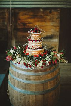 An old wine barrel brings a bit of bucolic beauty when serving as a cake pedestal.