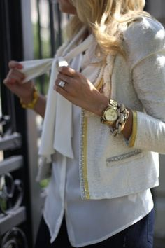 so in love w/the bow front blouse untucked w/a classic Chanel-like blazer w/the large watch & chunky bracelets...gorgeous