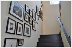Funk up your boring staircase- did this today, but didn't need to lay out the pics beforehand. I love it and can't wait to add to it. Stairway Photos, Stairway Gallery Wall, Picture Wall Staircase, Hanging Artwork, Home Pictures, Staircase Design, Furniture Makeover, Frames On Wall, Photo Wall