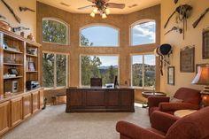 Southwestern Home Office with flush light, Ceiling fan, Carpet, High ceiling