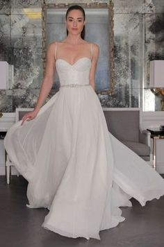 Fitted bodice with sweetheart neck, spaghetti straps and flowy skirt by @romonakeveza | Bridal Market Fall 2016