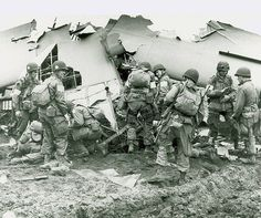 """101st Airborne Division troops that landed behind German lines in Holland examine what is left of one of the gliders that """"cracked up."""""""