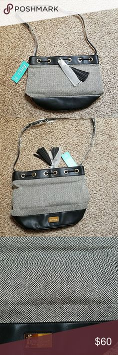 Initials Inc Bucket Bag Never been opened from the packaging, literally just now for pictures. I bought both the brown and the tweed black and decided I just like the brown. Adjustable strap, tassels, faux leather bottom, gold hardware, comes with a dust bag. Initials Inc. Bags
