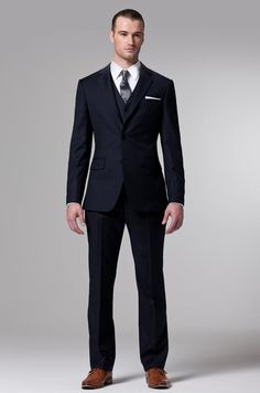 Dress up while beating the summer heat at an informal evening wedding in Indochinos Essential Navy 3-Piece Suit.