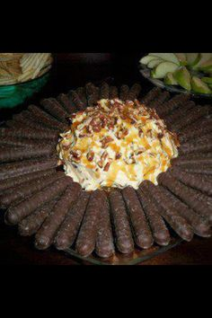Turtles Cheese Cake dip Ingredients: 8oz softened Cream Cheese 1/4 cup butter 1/2 tsp vanilla extract 1 1/5 tbsp brown sugar 1/3 cup icing sugar 1/2 cup chopped pecans 1/2 cup mini semisweet choc. chips 1/2 pkg vanilla pudding mix 1/2 cup Carmel topping plus a little more for drizzling. Cream softened cream cheese & butter. Add caramel topping & beat well. Cream in brown sugar & icing sugar. Add vanilla & dry pudding mix. Fold in chocolate chips and pecans. Pat into ball, refrigerate 1 hour.